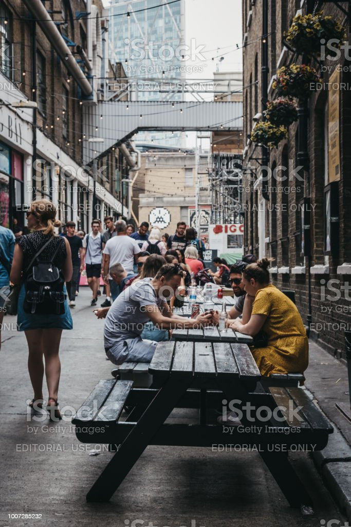 People Enjoying Street Food In Elys Yard Brick Lane London
