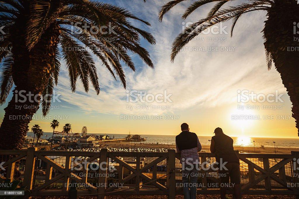 People enjoying sunset in Santa Monica, USA stock photo