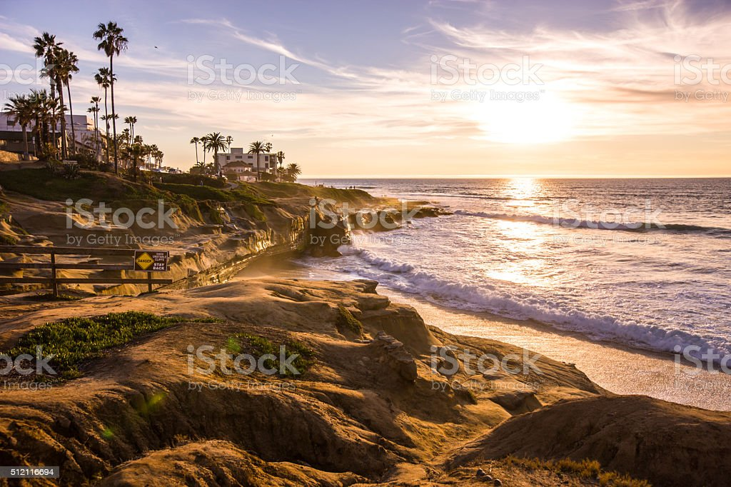 People enjoying sunset on La Jolla Beach, California, USA stock photo