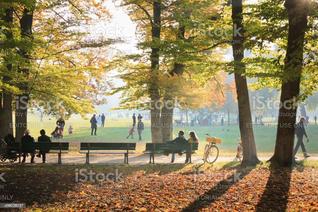 People enjoying the autumn sun in English Garden, Munich stock photo