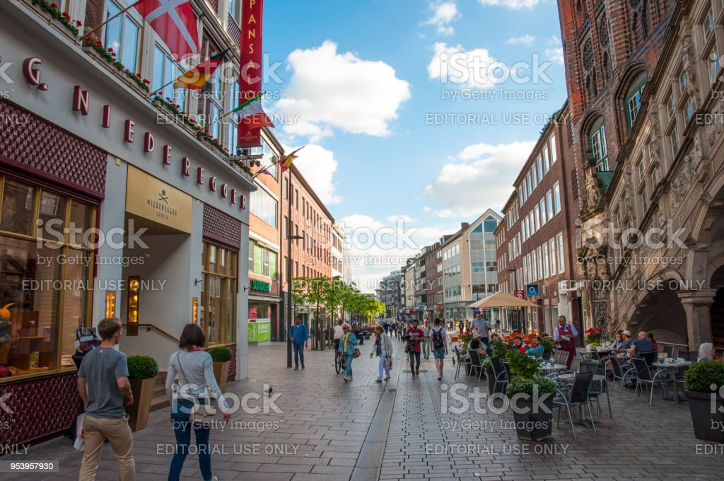 People enjoying the day in a small city street