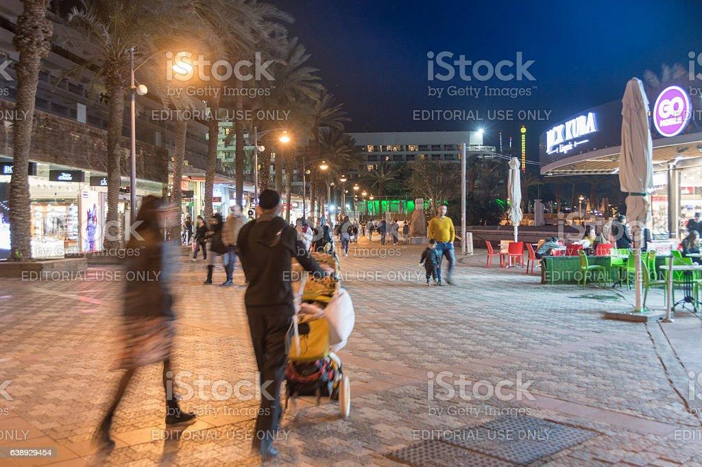 People enjoying the Eilat Promenade stock photo