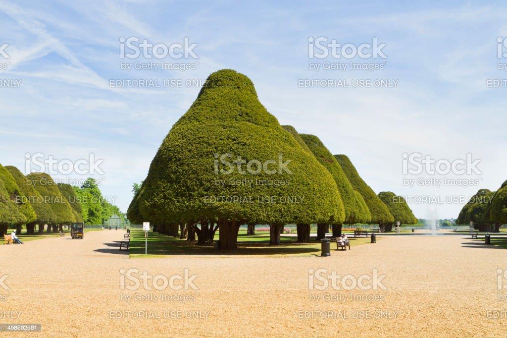 People Enjoying The Gardens At Hampton Court Palace stock photo
