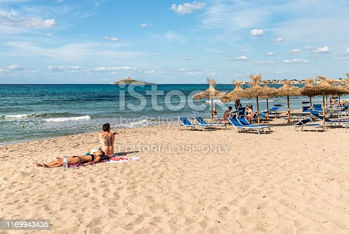Isola delle Femmine, Palermo, Italy - September 28, 2018: People enjoying the Isola delle Femmine beach and mediterranean sea in vacation, Sicily