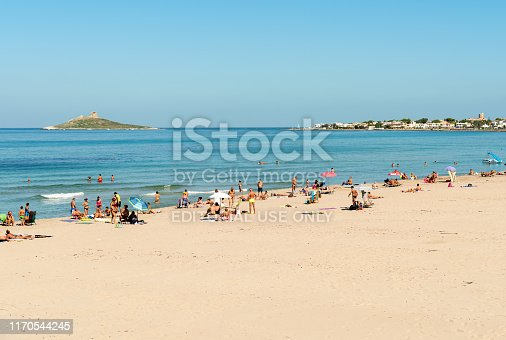 Isola delle Femmine, Palermo, Italy - September 30, 2018: People enjoying the Isola delle Femmine beach and mediterranean sea in vacation, Sicily