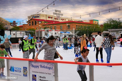 People enjoying the outdoor ice skating rink in downtown Tucson AZ