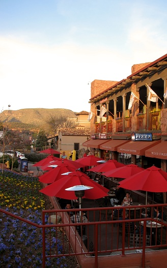 Sedona, AZ, USA - February 22, 2014: People enjoying a meal on the outdoor patio of Pizza Company Restaurant in Uptown Sedona.