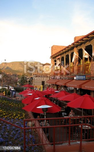 Sedona, AZ, USA - February 22, 2014: People enjoying a meal on the outdoor patio of Pizza Company Restaurant in Uptown Sedona.