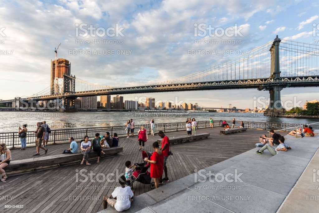 People enjoying the sunset over New York city from Brooklyn, USA stock photo