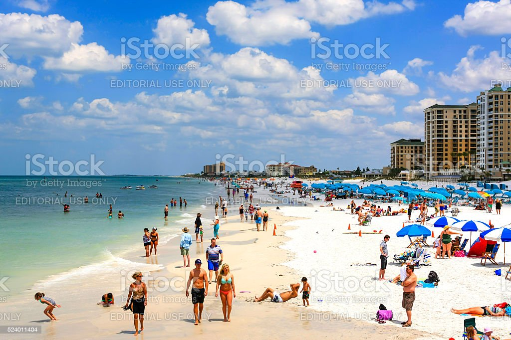 People enjoying the sunshine on Clearwater beach Florida stock photo