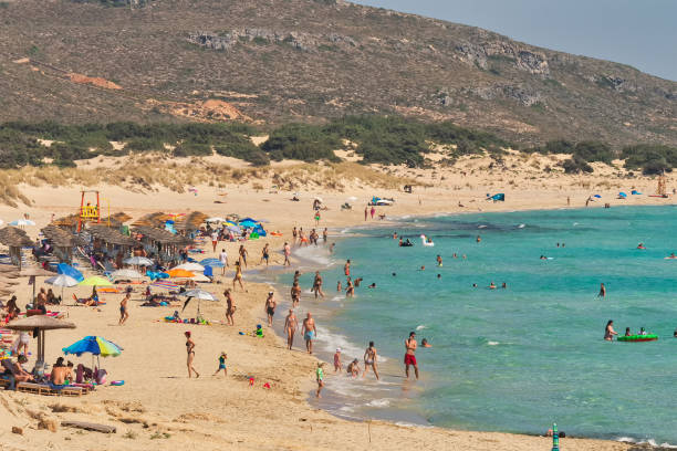 People enjoying their summer holidays at Simos beach in Elafonisos in Greece. stock photo