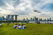 Singapore - 1 October 2016: People enjoying their weekend with different activities at the rooftop of Marina barrage