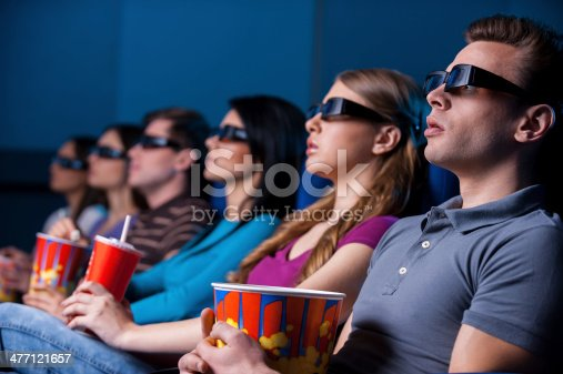 istock People enjoying three-dimensional movie. 477121657