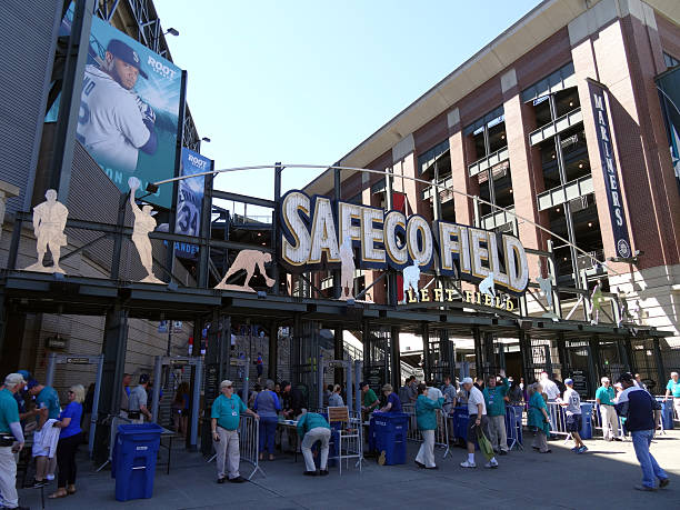 People enter into Left Field Gate to Safeco Field Seattle, United States - June 26, 2016: People enter into Left Field Gate to Safeco Field in Seattle in June 26, 2016. Home of the Seattle Mariners major league baseball stock pictures, royalty-free photos & images