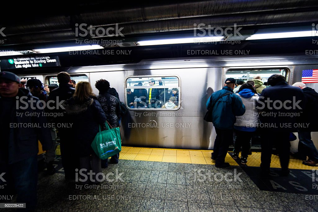People enter packed subway cars. NYC. Mass transit. #6 stock photo
