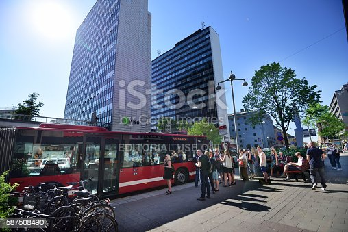 583973114istockphoto People entering bus at bus stop in Stockholm 587508490