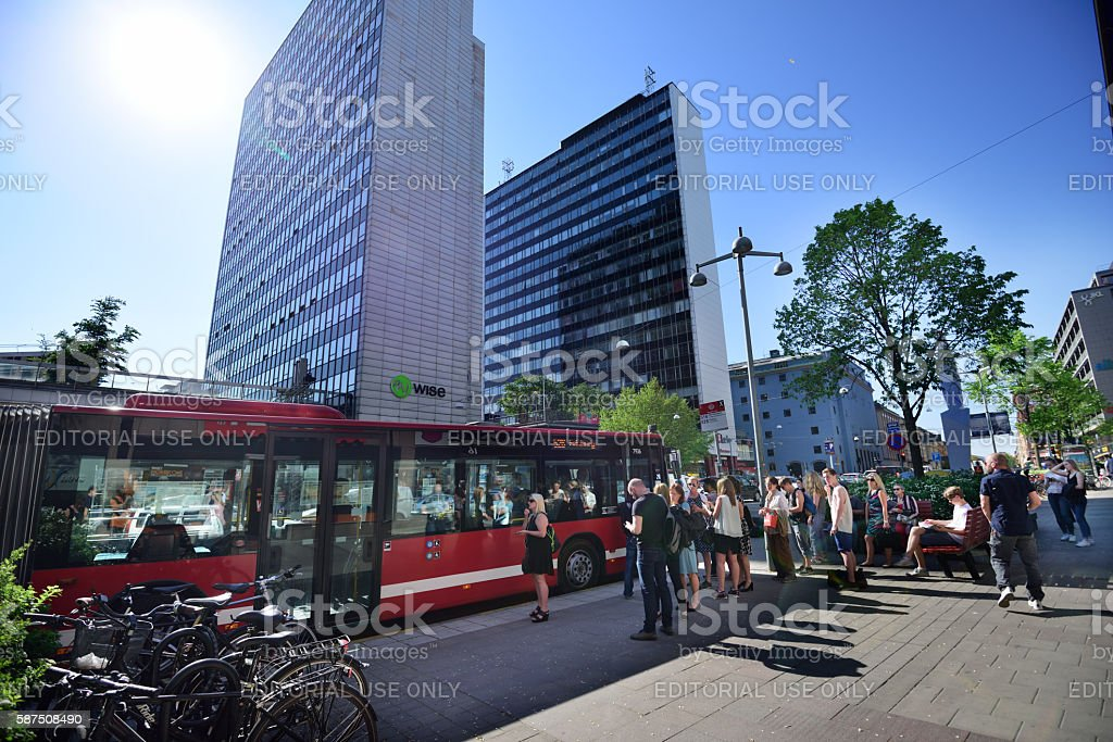 People entering bus at bus stop in Stockholm stock photo