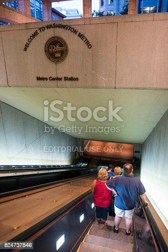 People descend an escalator into Metro Center station in Washington DC (June 2016)