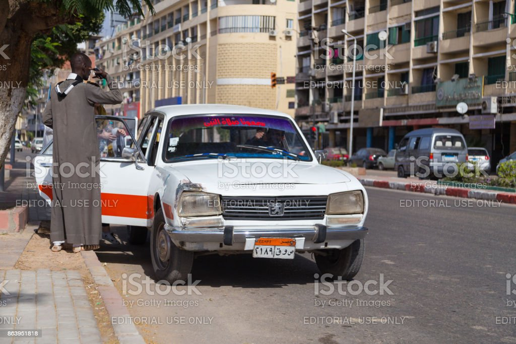 People Entering Old Peugeot 504 Taxi At Street Stock Photo More