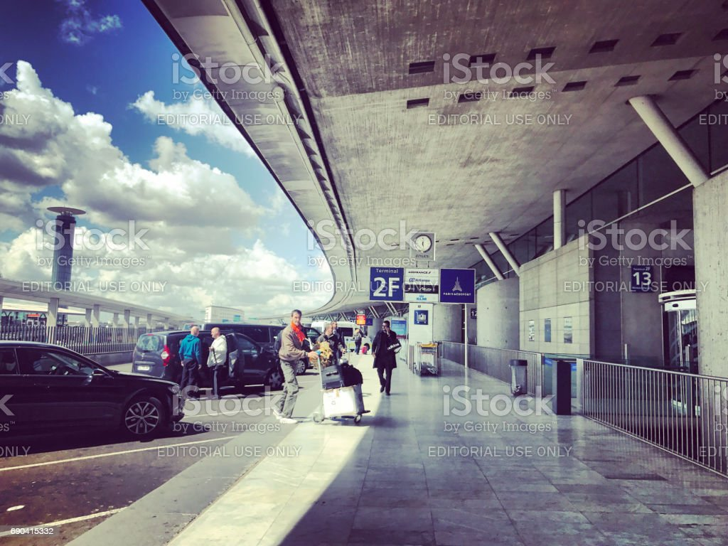 People entering Roissy Charles de Gaulle Airport in Paris, France stock photo