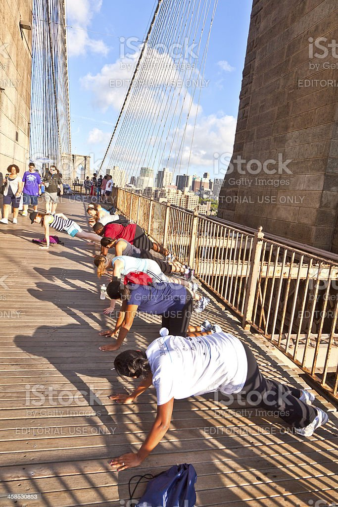 people exercise push-up at Brooklyn bridge royalty-free stock photo