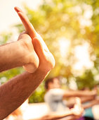 Group of People Exercise Tai Chi Outdoor, closeup of hands touching