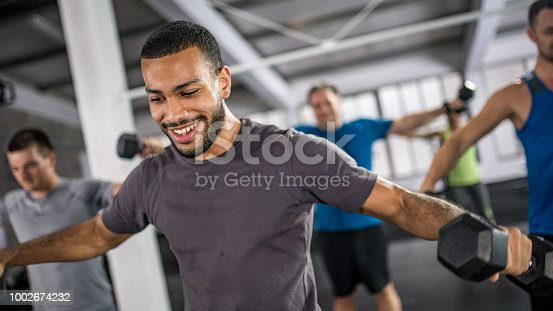 1069872470istockphoto People exercising in gym 1002674232