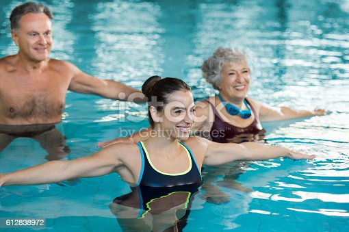 612839448istockphoto People exercising in pool 612838972