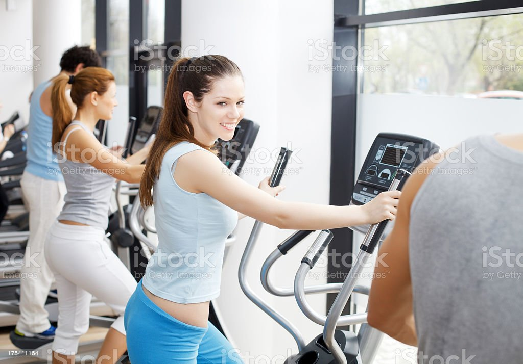People exercising on cardio machines in the gym. royalty-free stock photo