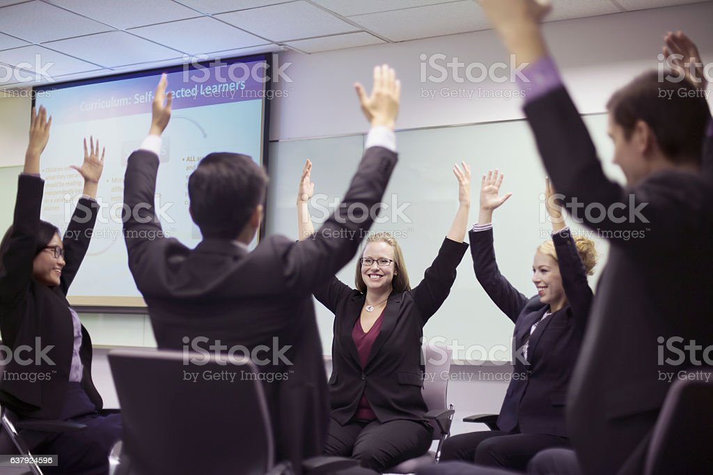 People exercising together in business conference meeting stock photo