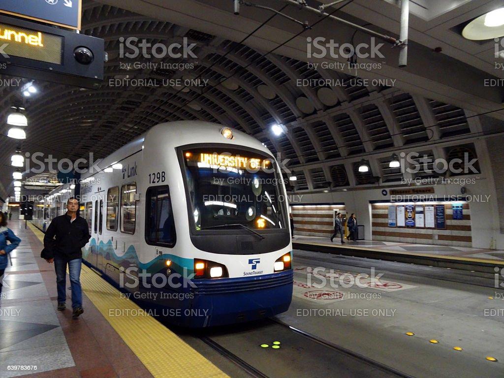 People exit Sound Transit light rail train stock photo
