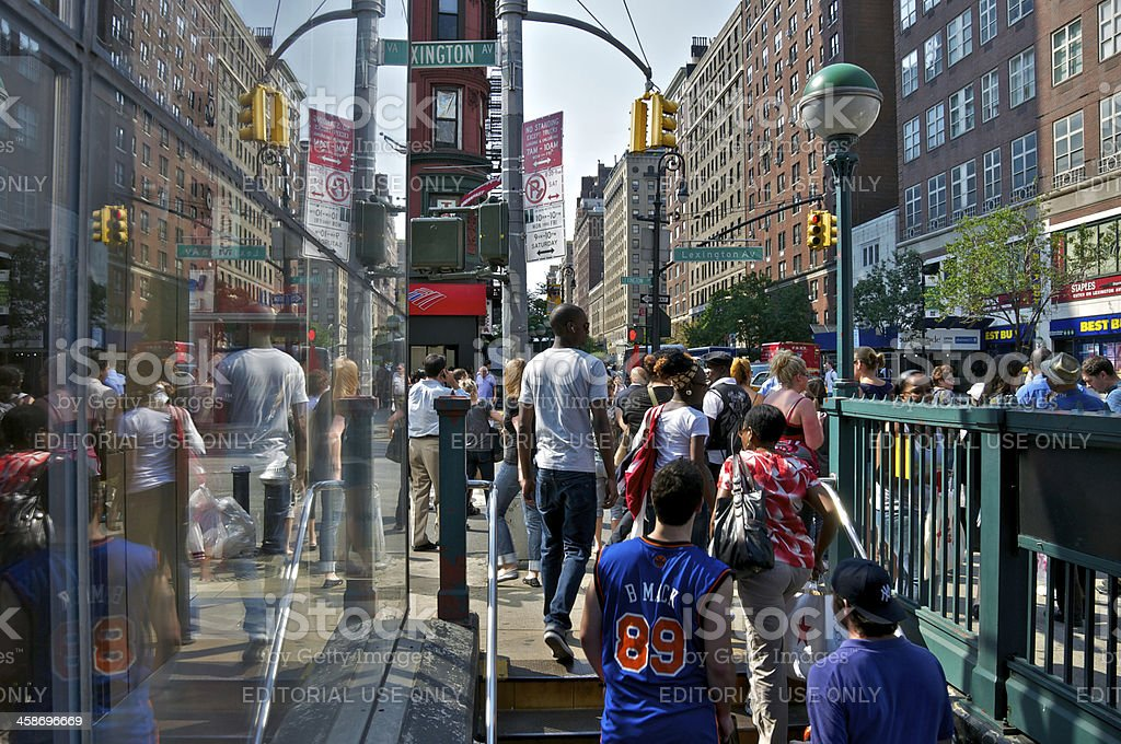 People exiting E.86th Street subway station at Lexington Ave, NYC stock photo