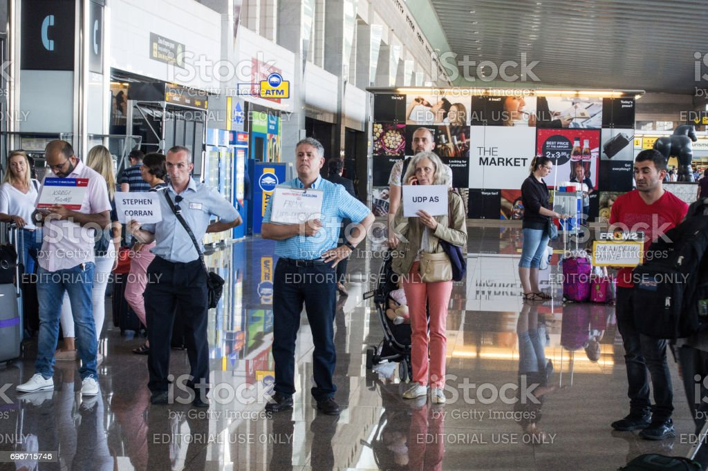 People expect the arriving passengers at the exit in Barcelona airport stock photo
