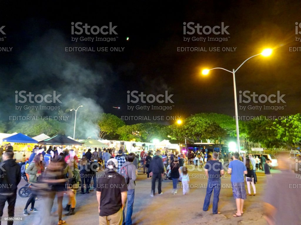 Crowd of People Explore Booth at New Years Eve Event in Kaka\'ako Park...