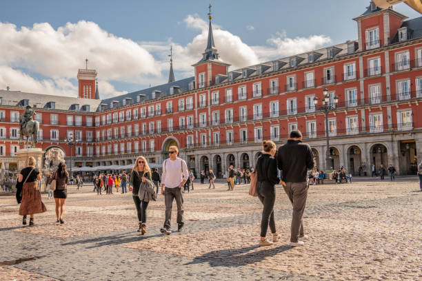 People explore historical Plaza Mayor in central Madrid stock photo
