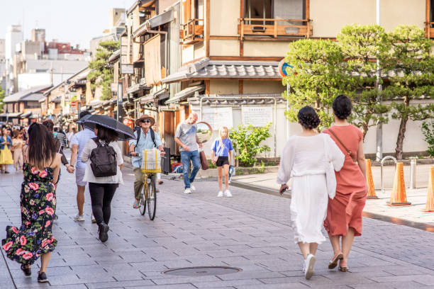 People explore the historic streets of Gion in Kyoto, Japan stock photo