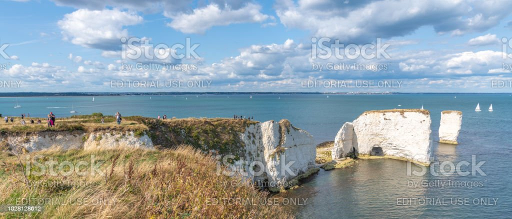 People exploring Old Harry Rocks in Dorset stock photo