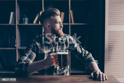 istock People fail coziness holiday concept. Profile side half-faced portrait of serious gloomy minded nervous thinking pondering pensive dreamy handsome manager enjoying cool fresh beer at bar counter 960217876
