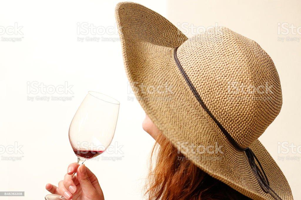 People fashion wine-tasting hats portraits photography woman dress feminine indoor stock photo