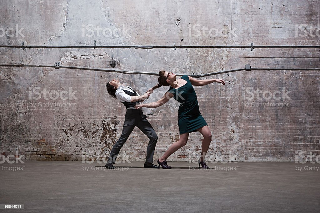 People fighting in warehouse royalty-free stock photo