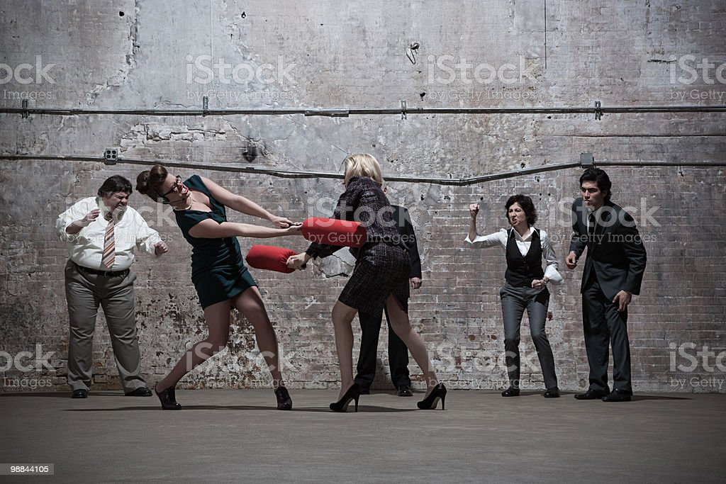 People fighting in warehouse royalty free stockfoto