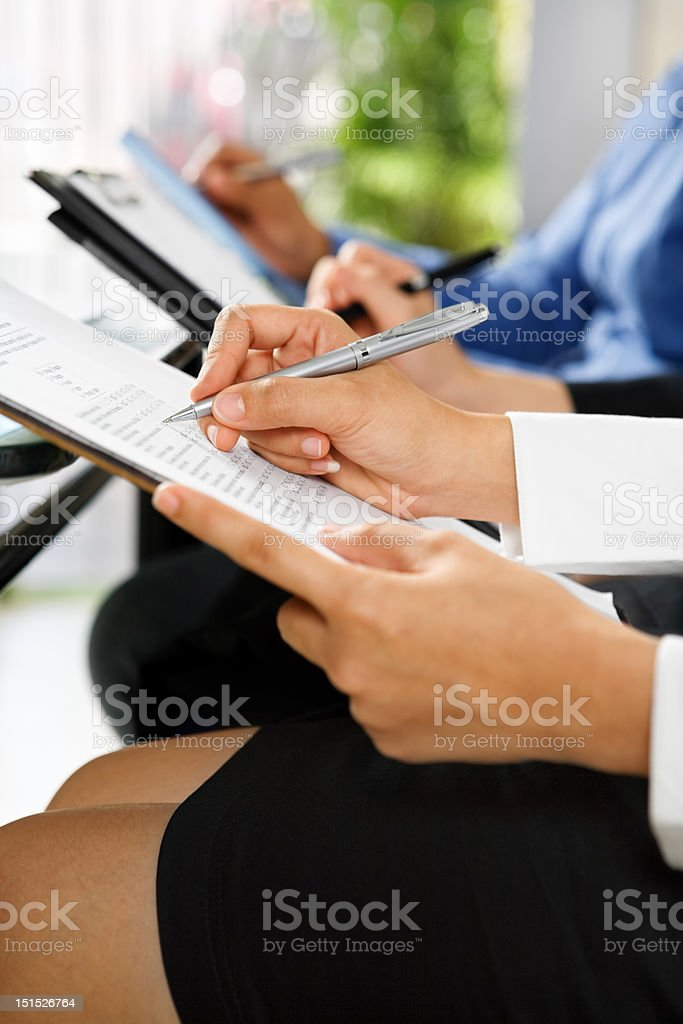 People fillling questionairre form royalty-free stock photo