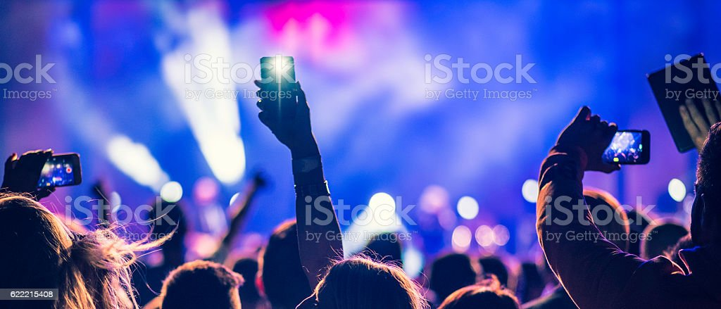 People filming a concert stock photo