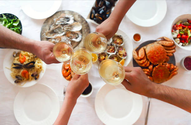 People fine dining seafood and white wine on the table stock photo