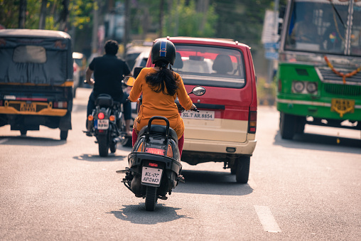 A man riding a bike in the street of Kochi in India