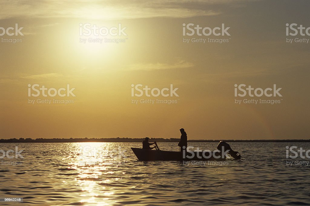 people fishing in sunrise royalty-free stock photo