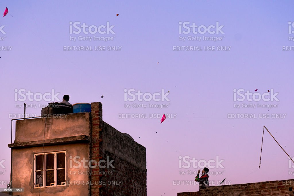 People flying kites from houses in Jaipur stock photo
