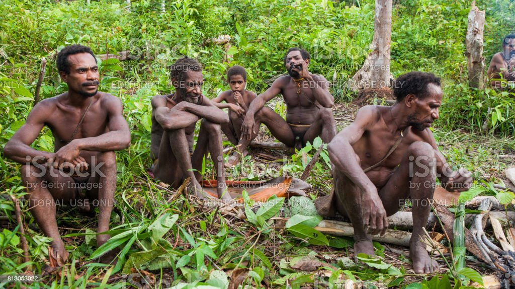 People From The Korowai Tribe Near Its Traditional Hometribe Of
