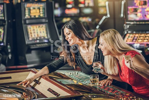 People gambling in the casino