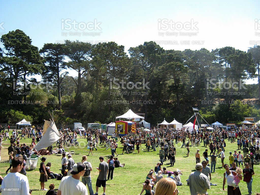 People gather and check out booths stock photo